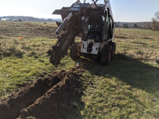 Bobcat Trencher to Install PVC for Cable Feeds to Antennas